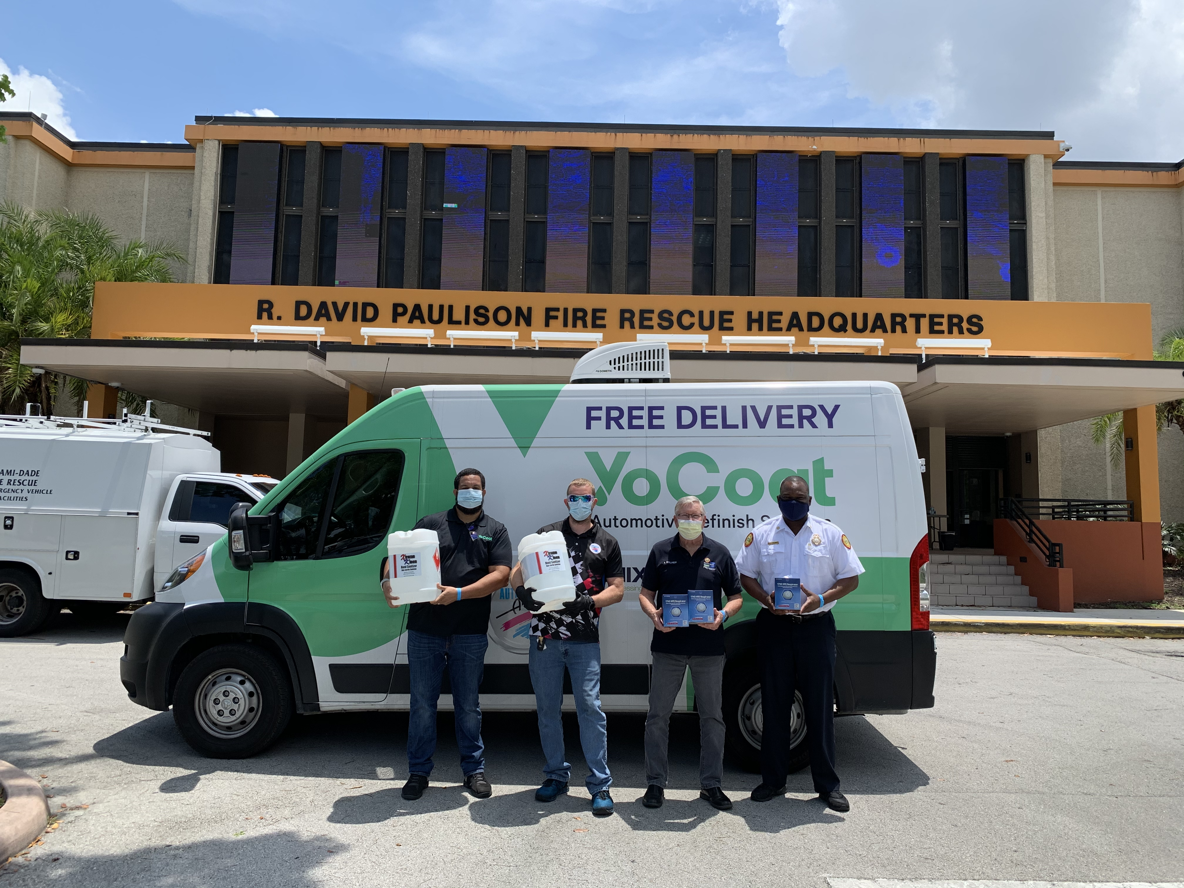 Automotive Art and YoCoat Team Members along with Miami-Dade Police and Fire handing over donated products.