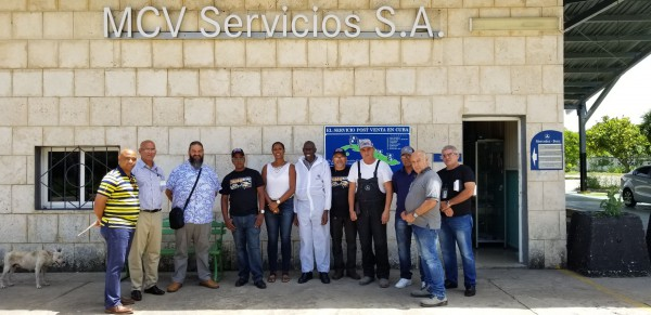Peter Padmore, Technical Representative of Automotive Art, poses with painters after the workshop in Havana, Cuba